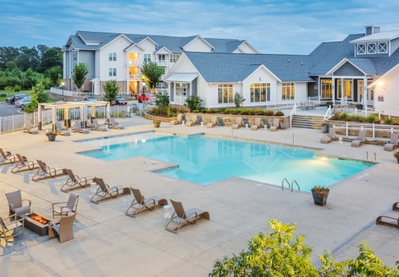 Resort-style swimming pool with large sundeck and poolside fire pit at the Station at Poplar Tent