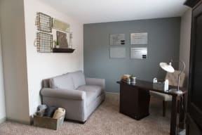 The Southern Apartments Living Room with Carpet Floors and Nook for Home Office Space