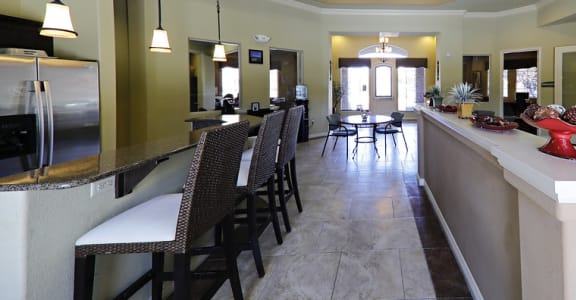 Beautiful clubhouse with a kitchen area and sitting area with TV and fireplace