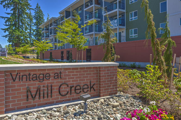 Community Building and sign Vintage at Mill Creek Senior Apartments in Mill Creek WA 98012