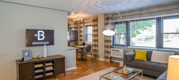Open living area with large windows at Bridgeyard in Alexandria, VA