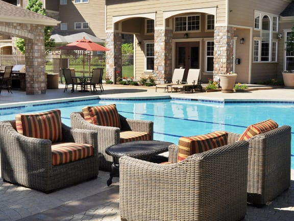 Resort-Style Swimming Pool and Sundeck Lounge at 80112 Apartments for Rent in Englewood
