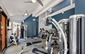 Fitness Room with weight equipment  l Enclave apartments in Paramount CA