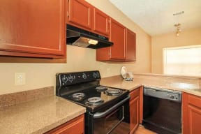 Spacious Kichen with Black Appliances and Custom Cabinetry