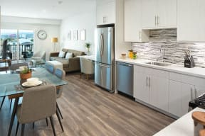 Full kitchen, dining and living area view