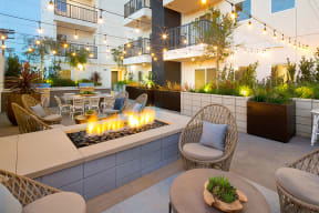 Rooftop lounge with fire pit and seating