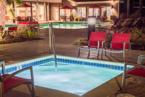 Spa by pool with seating  l Kirker Creek Apartments