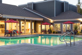Evening pool view with seating  l Kirker Creek Apartments