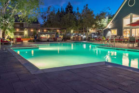 Pool view with seating  l Kirker Creek Apartments