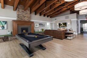 Clubroom with billiards table and fireplace