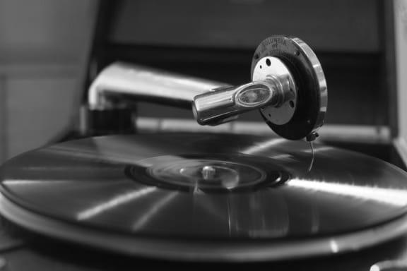 Vinyl record on record player at Mirabella Apartments, 92203, CA
