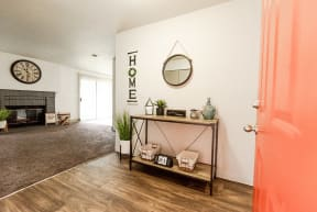 Lakewood Apartments - Crown Pointe Apartments - Entryway, Living Room, and Fireplace