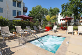 Apartments in Santa Rosa CA-Annadel Apartments Relaxing Spa with Lounge Chairs and Umbrellas