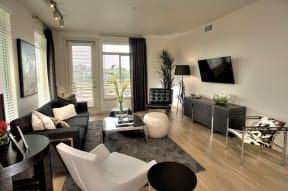 Santa Rosa CA Apartments-Annadel Apartments Spacious Living Room with Hardwood Floors and Patio Access