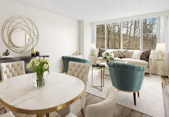 modern furnished living room with cream and sage furniture