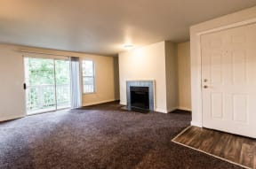Tacoma Apartments - Sienna Apartments - Living Room, Deck, Fireplace, and Entryway