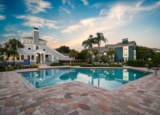 Clubhouse Overlooking The Pool & Sundeck At Twilight