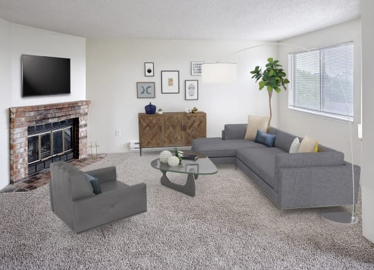 Living room with couch and chair with coffee table in the middle.  Decorated with a plant, floorlamp, and wall art, with a tv above the fireplace.