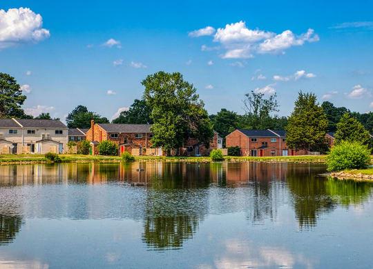 Lake and buildings at Crystal Lake Apartments