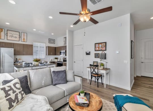 Living Room With Kitchen View at Parke Place Apartments, P.B. BELL Assets Management Prescott Valley, AZ