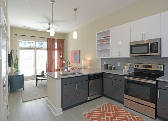 Electric Range In Kitchen at Link Apartments® Innovation Quarter, Winston Salem, North Carolina