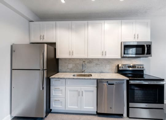 Stainless steel kitchen and white cabinets at Connecticut Plaza Apartments, Washington, District of Columbia