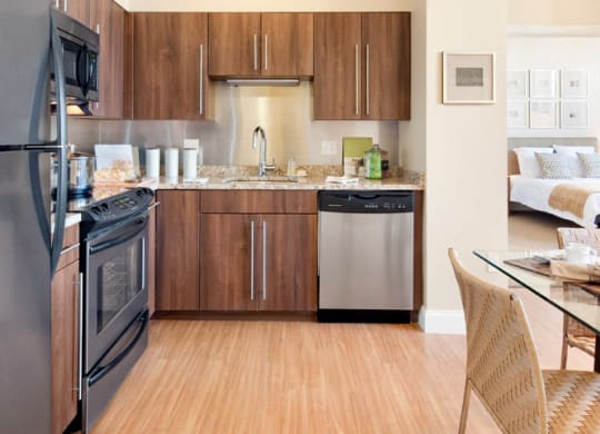 Kitchen with wood floors at Wilber School Apartments, MA, 02067