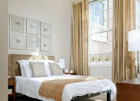 Sun lit master bedroom at Wilber School Apartments, Sharon