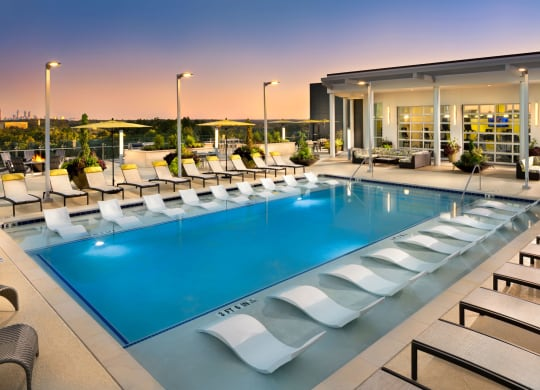 Swimming Pool with Lounge Seating at The Encore by Windsor, Georgia
