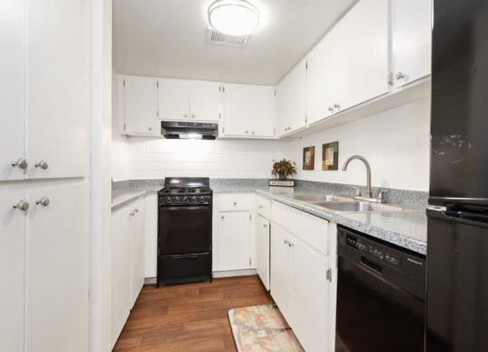 Model kitchen with white cabinets and energy-efficient appliances