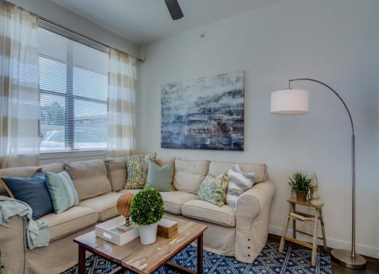 Living Room With Expansive Window at Aviator at Brooks Apartments, Clear Property Management, San Antonio, Texas