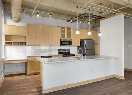 Open Kitchen with Eat-In Breakfast at Lowertown Lofts, St. Paul, Minnesota