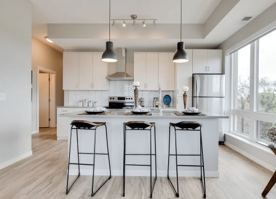 Spacious Kitchen Island with Stylish Pendant Lights at The Whit, Minnesota, 55404