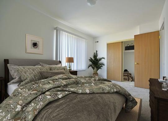 Bedroom With Closet at Charter Oaks Apartments, Michigan