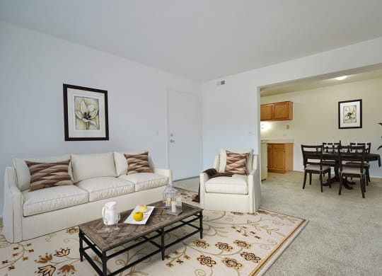 Living Room With Dining Area at Charter Oaks Apartments, Davison, Michigan