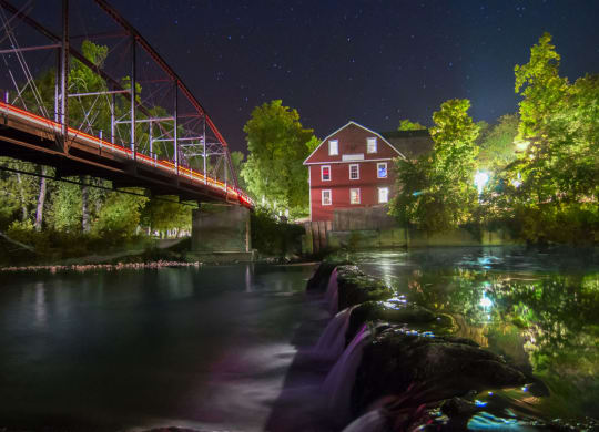 Night View of War Eagle Mill and Bridge in Rogers, AR