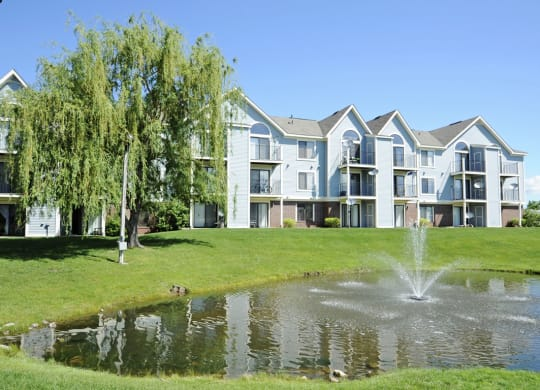 Lake With Lush Natural Surroundings at Huntington Cove Apartments, Merrillville, IN
