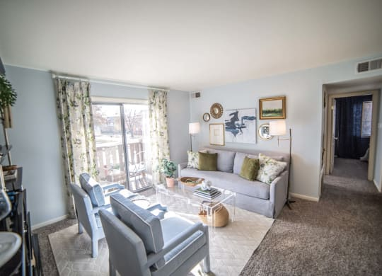 Living Room With Private Balcony at Bavarian Village Apartments, Indianapolis, 46235