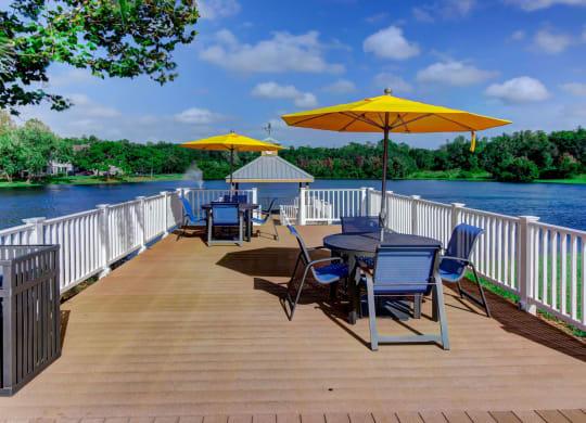 Lake with gazebo deck and seating arrangements at Citrus Park, Tampa, FL, 33625