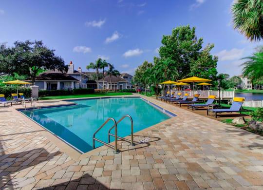 Swimming Pool with Sun Deck and Ample Comfortable Lounging at Berkshires at Citrus Park, Tampa, Florida