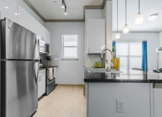 Efficient Appliances In Kitchen at Berkshire Preserve, Garland, 75044
