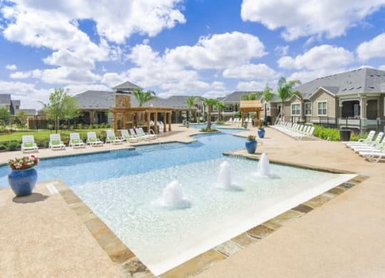 Swimming Pool And Fountain at Villages of Briggs Ranch, San Antonio