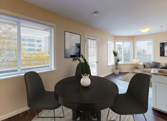 Dining area with a round dining table and 4 chairs. One window in the dining area.
