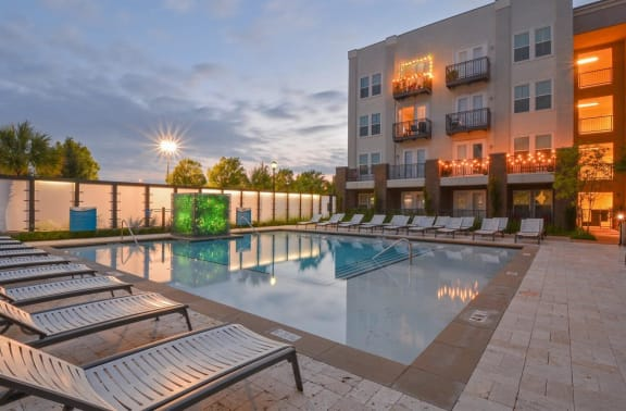 sparkling pool with sundeck   Parkside at Firewheel Apartments in Garland, TX