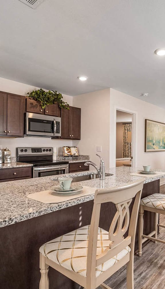updated kitchen with stainless steel appliances at Emerald Lakes South, Ocean Springs