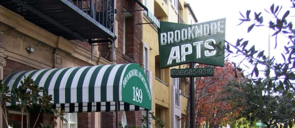 Brookmore Entrance with Vintage Awning and Neon Sign