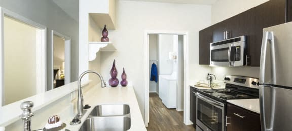 Apartments in Aurora - Aspen Ridge Kitchen with Wood Style Flooring, Updated Appliances, and Ample Counter Space
