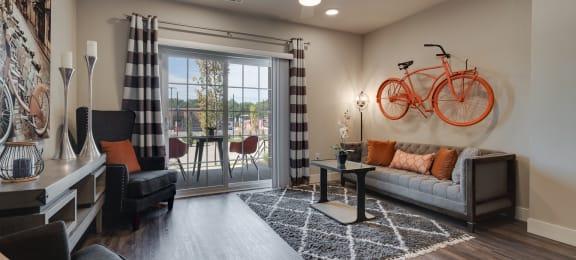 Living Room With Glass Sliding Patio Door & Wood-Style Flooring