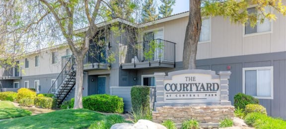 Welcoming Property Signage at Courtyard at Central Park Apartments, Fresno, California
