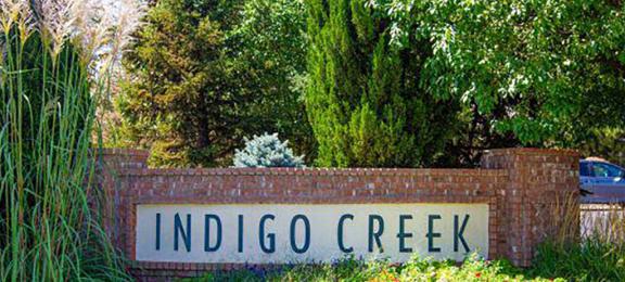 Welcoming Property Sign at Indigo CreekApartments, Colorado